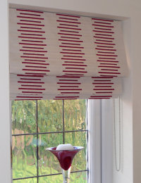 Hanging curtain blinds in white and red by Daisychain Curtains