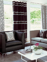Dark brown curtains with stripes and matching cushions by Daisychain Curtains